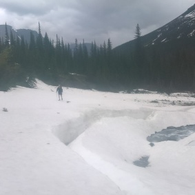 a collapsed snow bridge over river