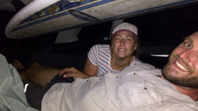 the tight space in back of a full vehicle surfboard above, campchairs around legs