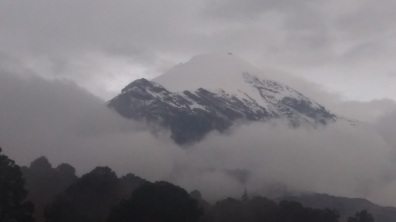 the top of Pica de Orizaba, the mountain hut is behind the black rocky ridgeline to the left, this is taken from 12,000ft
