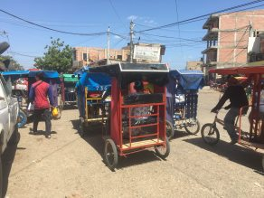 bicycle taxis heading into the market